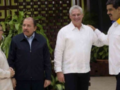 Venezuelan President Nicolas Maduro greets his Cuban and Nicaraguan counterparts, Miguel Diaz-Canel and Daniel Ortega (right to left), at the ALBA-TCP Summit in Havana. (Reuters)